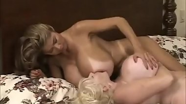 Busty lesbian love play with boobs