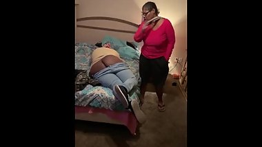 Girl gets spanked for not picking up the clothes