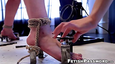 Submissive lesbian tied up and dominated over by femdom