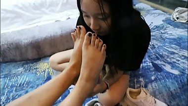 Lesbian friends smell each other's feet